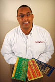 African American man with glasses holding tcs products